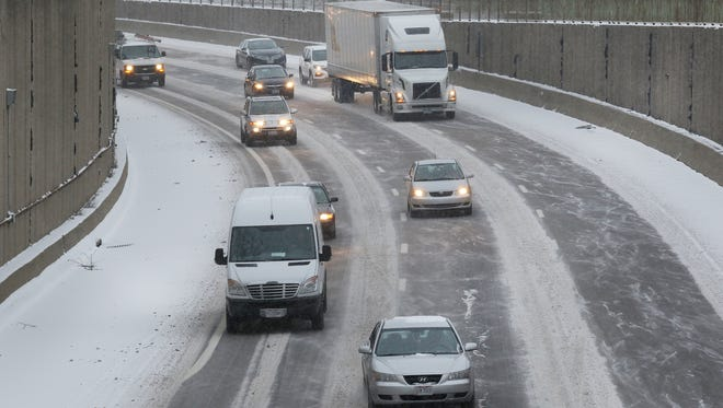 Traffic heads south on Interstate 75 at the Lockland split on Wednesday after two inches of snow fell across the region.