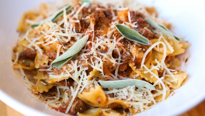 The pork shoulder bolognese with apples, sage and farfalle at Over the 9.