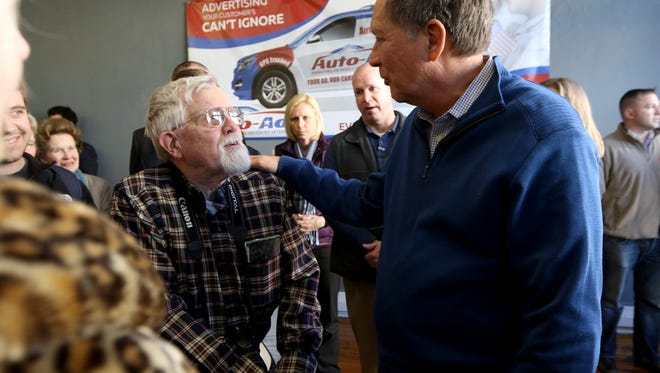 Ohio governor John Kasich, right, talks with Roy Denham, a University of Cincinnati graduate (class of 1954) who lives in West Virginia, during a town hall event at in Charleston, South Carolina Wednesday February 10, 2016.