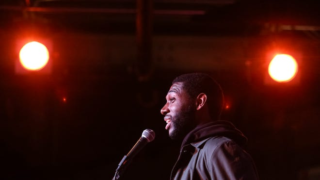 """Award-winning hip-hop artist Jecorey """"1200"""" Arthur speaks during the sold out CJ Storytellers music themed event at the Tim Faulkner Gallery in Portland. Feb. 15, 2016"""