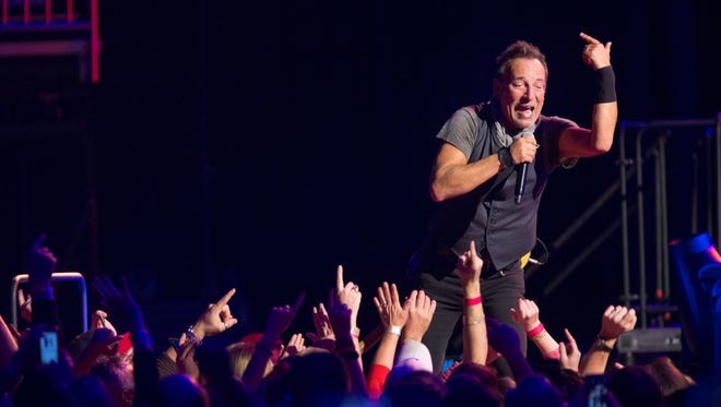 Bruce Springsteen interacted with the crowd during a concert at the YUM! Center. Feb. 21, 2016.