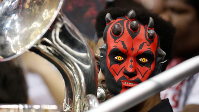 A Louisville band member played while wearing a Star Wars mask at the women's basketball game against Pitt.