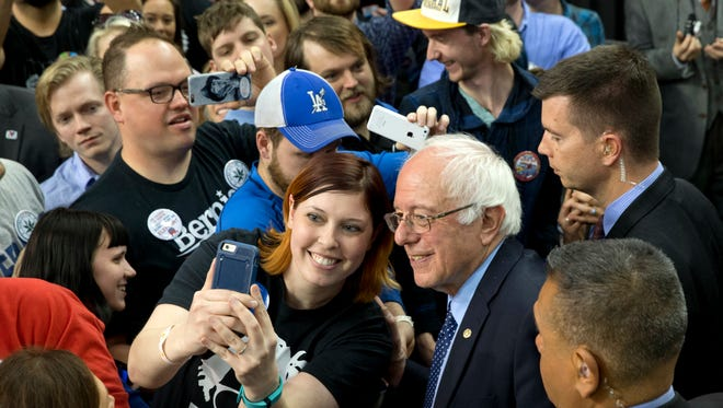 Democratic presidential candidate Sen. Bernie Sanders poses for a selfie during a campaign rally at  in Oklahoma City, Okla., Sunday.