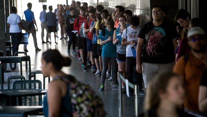 Voters wait in line to cast their ballots at the Flawn Academic Center on the University of Texas at Austin campus on Tuesday, March 1, 2016 in Austin, Texas.