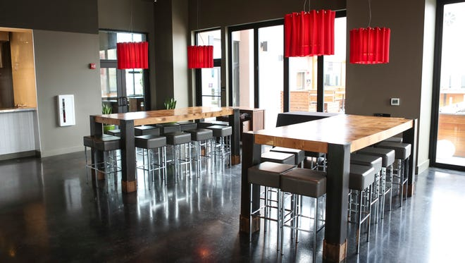 Indoor seating near the outdoor patio at 8 UP Elevated Drinkery & Kitchen. March 25, 2016