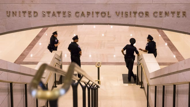 FILE - In this Oct. 7, 2013 file photo, the strairs leading to the Capitol Visitors Center on Capitol Hill in Washington.  The U.S. Capitol Police are telling staff in the Capitol complex to shelter in place after a report of gunshots being fired in the Capitol Visitors Center. (AP Photo/J. Scott Applewhite, File)