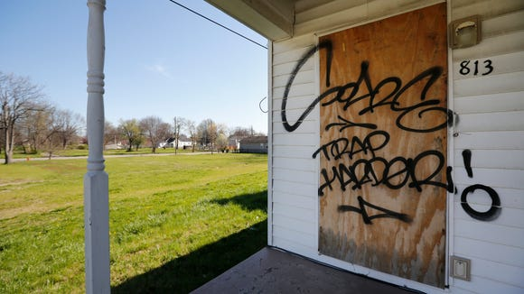 Empty lots and boarded houses make up the landscape