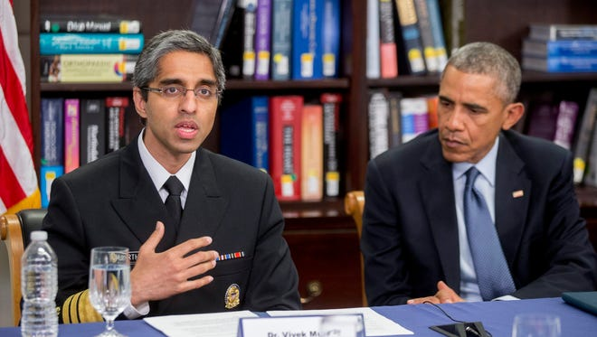 President Obama listens to Surgeon General Vivek Murthy while participating in a roundtable discussion on the impacts of climate change on public health at Howard University in Washington on April 7, 2015.