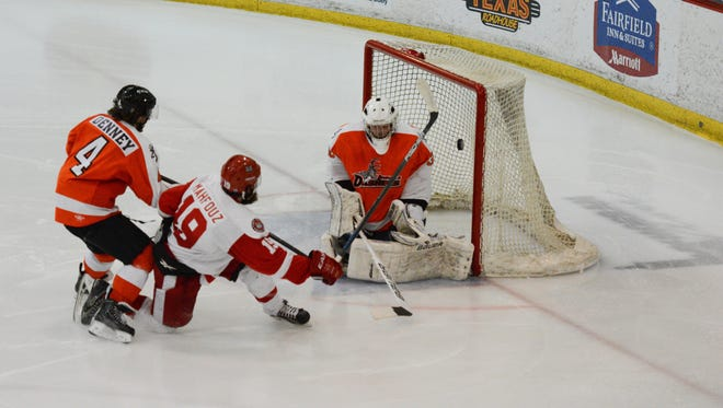 Port Huron Prowlers forward Ahmed Mahfouz gets off a shot against the Danville Dashers