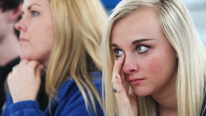 """Valley High student Emily Lacy wipes tears from her eyes as she listens to stories of loss to drunk driving during the """"Ghost Out"""" event Tuesday."""
