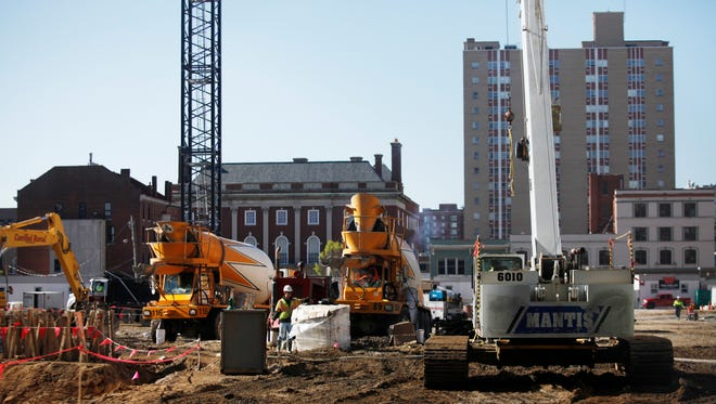 Construction workers on the site of the new Omni Hotel being built in downtown Louisville. April 13, 2016.