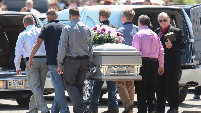 The caskets of Lauren Owens, Samantha Owens and her two-month-old son Liam McCarty are carried out of the Colgate Baptist Church in Clarksville, Ind. on Friday afternoon following a church service. Lauren, a fourth grader, Samantha, a 2012 Clarksville high graduate, and Liam were all killed in a tragic traffic accident on I-64 last Saturday evening. April 15, 2016