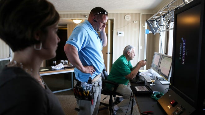 This 2016 file photo shows Thunder over Louisville Director Mandie Creed-Clark, from left, AT&T's Kenny Johnson and Thunder producer Wayne Hettinger work on setting up the hardware in the control room of the Galt House.