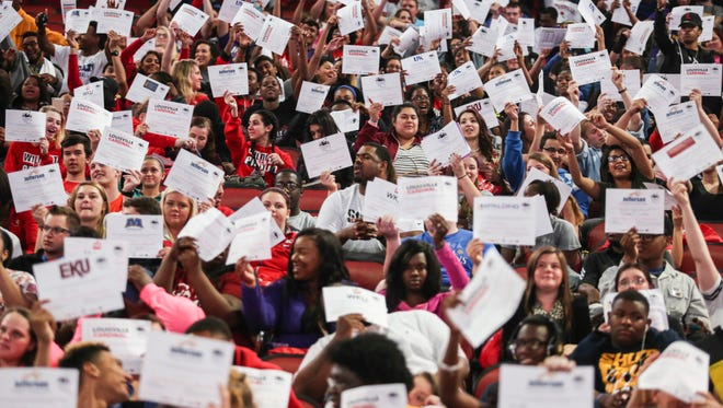 """Over 1,000 college-bound seniors from Jefferson County hold up signs declaring the colleges they will be attending during a """"College Signing Day"""" ceremony at th KFC Yum! Center on Friday."""