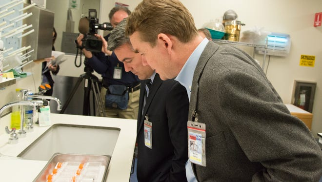Sens. Cory Gardner and Michael Bennet tour the CDC lab in Fort Collins in this file photo. Bennet, a Democrat, is urging Congressional funding so the lab can continue its research into Zika.