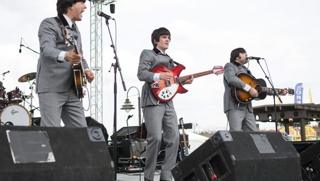 Members of the Hard Day's Night Beatles tribute band perform at Abbey Road on the River on Friday at Belvedere Festival Park. May 27, 2016