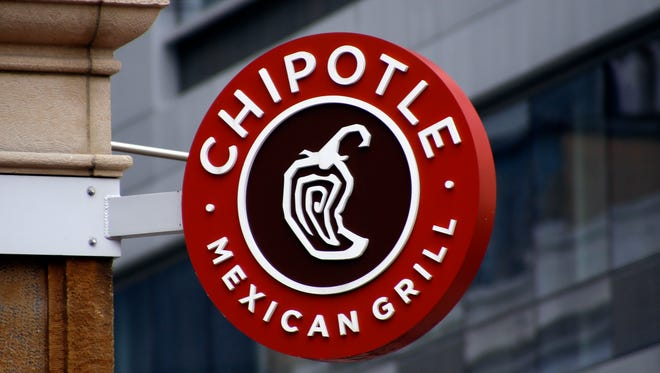 "This Monday, Feb. 8, 2016, photo shows a sign for the Chipotle restaurant in Pittsburgh's Market Square. Chipotle is introducing a temporary loyalty program intended to get customers back into its stores following a series of food scares. On Monday, June 27, Chipotle said its ""Chiptopia"" loyalty program will reward people based on the number of times they visit each month, starting in July and running through September. The program has three reward levels, with more visits translating to more free entrees and other benefits. (AP Photo/Keith Srakocic)"