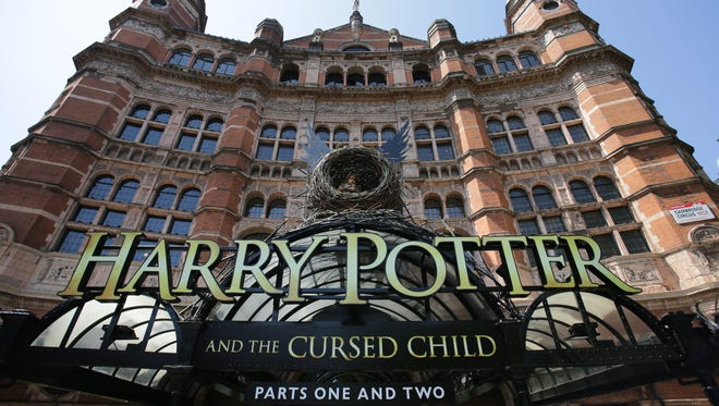 The front of the Palace Theatre promotes its new show 'Harry Potter and the Cursed Child'  in London on June 6, 2016. Harry Potter makes his stage debut on June 7 in a new London play that imagines the fictional boy wizard as a father of three, in the latest offshoot of the globally successful franchise.