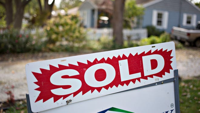 A sign stands outside of a home in Peoria, Illinois, on Oct. 20. Sixty percent of people who sold a home in the U.S. over the last year got a discount from their agent, according to real estate brokerage Redfin