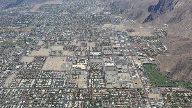 An aerial view shows the checkerboard pattern where development and undeveloped areas are side by side in certain areas of Palm Springs.  This aerial view is looking south.