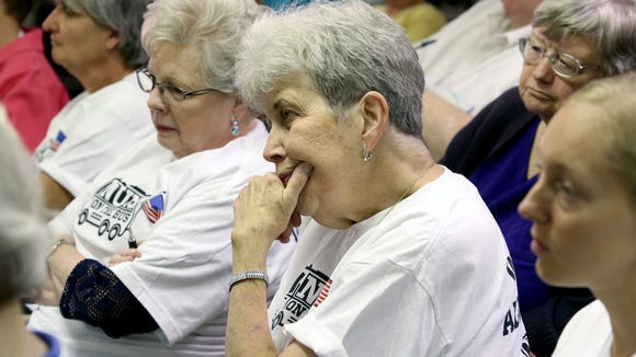 Members of Nuns on the Bus Cincinnati and others listen