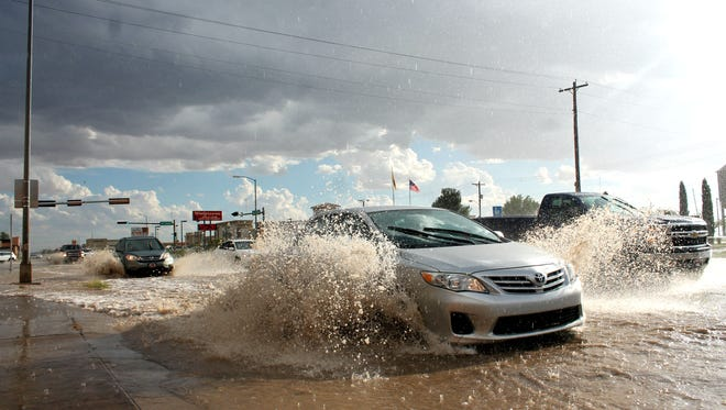 A car navigates its way through heavy flooding on White Sands Boulevard on Thursday evening. The National Weather Service issued a flash flood warning over Otero County until 8:30 p.m. Thursday. The National Weather Service's doppler radar indicated thunderstorms producing heavy rain across the area had produced two inches of rain and quarter size hail.