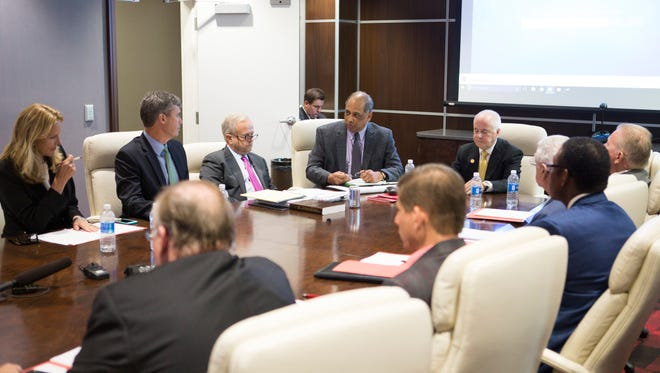 Members of the U of L Foundation board, with now former chairman Bob Hughes at the head of the table, meet Friday and agreed to accept U of L President James Ramsey's resignation. Sept. 16, 2016