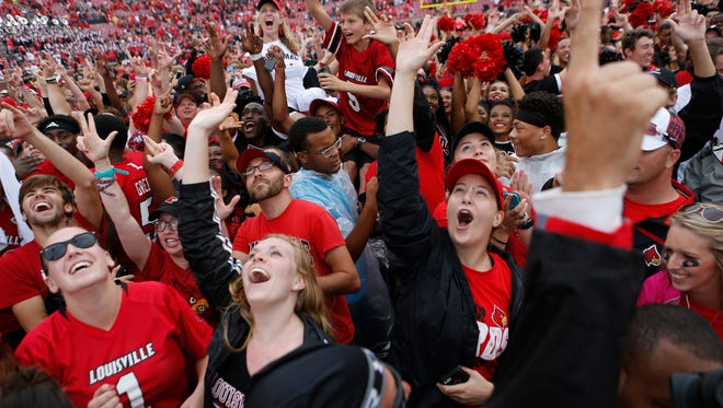 Louisville fans take to the field to celebrate after defeating Florida State 63-20. Sept. 17, 2016