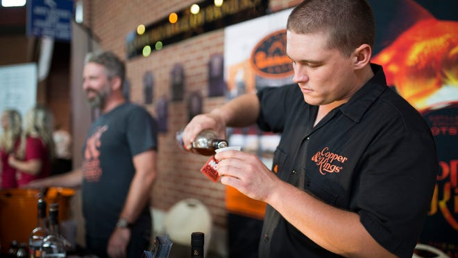 """Copper & Kings Matt Edwards fills a glass at the 2016 Louisville Brewfest at Louisville Slugger Stadium. """"It's cook to have craft breweries and distilleries making contact with the public,"""" Edwards said. """"They get to have the products explained in a way they wouldn't be in a liquor store."""" Sept. 23, 2016"""