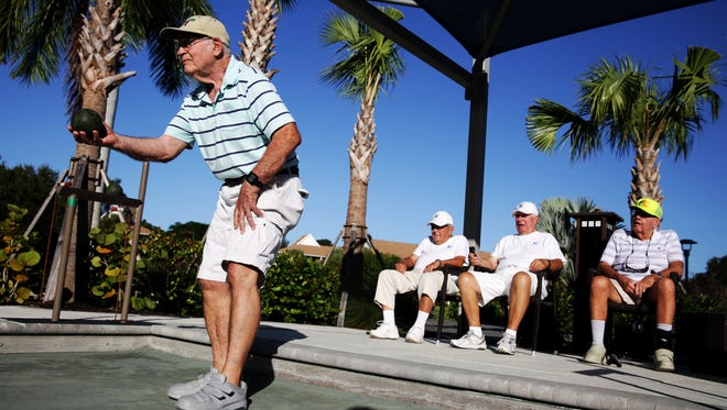 Jim Courtney, 85, takes his turn during a bocce ball competition at Bentley Village in Naples on Friday, Oct. 14, 2016.