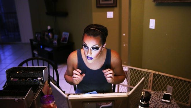 Andy Spaulding, 32, applies makeup to become Alyssa Lemay in his Fort Myers home on Friday, Oct. 14, 2016. Alyssa Lemay has been doing drag shows for 10 years, and she is a regular at Bambusa Bar & Grill in Naples.