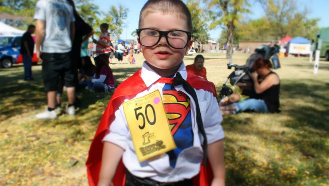 Jeremiah Prudencio, dressed up as Clark Kent, relaxes after he comes off stage during the costume contest.