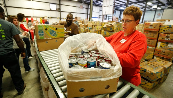 Lori Manning finished boxing an assortment of canned goods at Dare to Care. Manning volunteered at the local non profit food bank. Nov. 1, 2016.