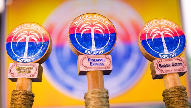 Naples Beach Brewery beer taps display three of their beers at the second annual Marco Island Craft Beer Festival on Sunday, Nov. 6, 2016, on Marco Island.