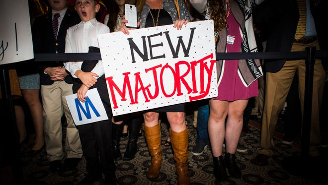 "A woman holds a ""New Majority"" sign during the Republican event at the Galt House in downtown Louisville on election night. Nov. 8, 2016"