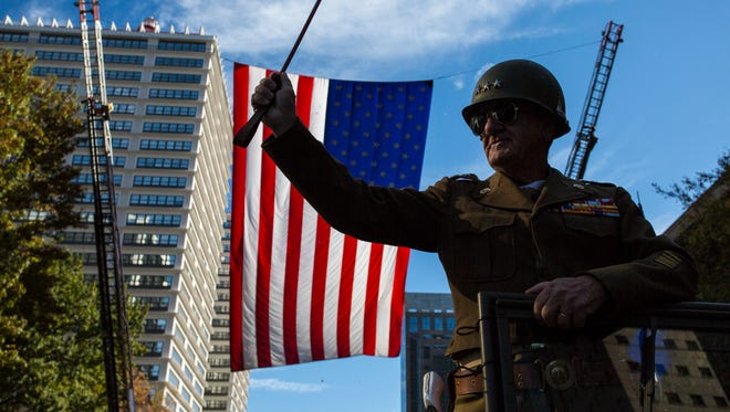 Retired Army Master Seargent James Goodall makes his way down Main Street during the Veterans Parade in downtown Louisville on Friday. Nov. 11, 2016