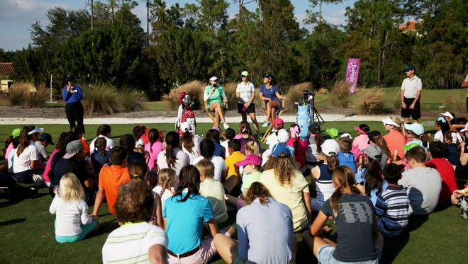 Kim Kaufman, left, and Danielle Kang answer questions from a group of children during the CME Group Tour Championship at Tiburón Golf Club in Naples, Fla. on Saturday, Nov. 19, 2016.