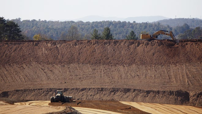 Duke Power's 1982 coal ash basin at the Lake Julian power plant contained 3.7 million tons of coal ash, nearly all of which went to the Asheville Regional Airport and into a lined landfill.