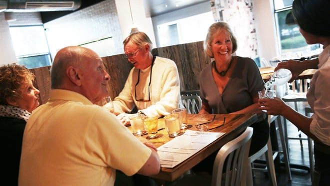 From left, Cynthia and Russ Hammer and Dennis and Marion Grant, all of Naples, are served by Allison Byers at MidTown Kitchen and Bar in Naples on Friday, Nov. 25, 2016.