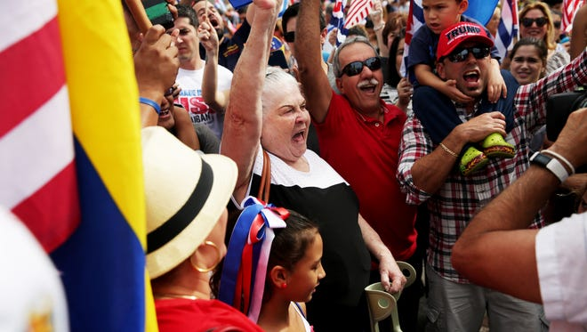 """People celebrate the death of Fidel Castro along """"Calle Ocho,"""" or 8th Street, in Little Havana, Miami on Friday, Nov. 26, 2016. Castro's death was announced by Cuban state television on Friday."""