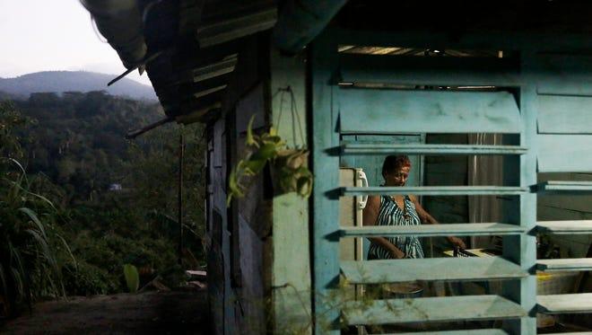 Enilda Cara Mendoza, 70, prepares for an evening bath in her home in El Cristo, Cuba, on Friday, Dec 2, 2016.