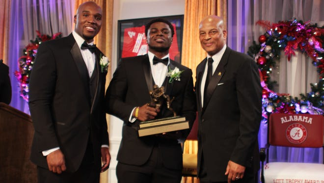 Michigan's Jabrill Peppers and football legend Ronnie Lott pose after Peppers was awarded the Lott IMPACT Trophy Sunday in Newport Beach, Calif.