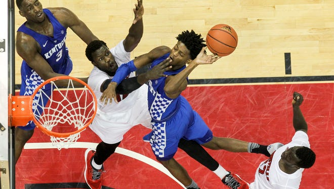 Players fight for a rebound during the U of L and UK basketball game at the KFC Yum Center on Wednesday night. Dec. 21, 2016