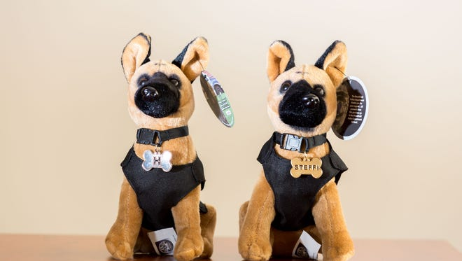 The Marshfield Police Department sells stuffed versions of its two dogs, H and Steffi, in hopes to raise $5,000 for its police dog fund.