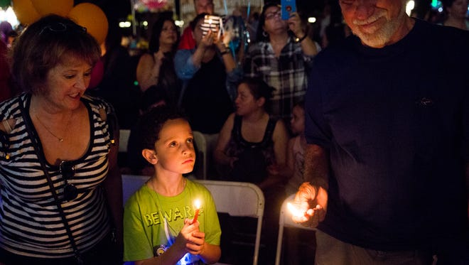 Gabriel Cooper, 7, of Minneapolis holds a candle during Chanukah and the Chocolate Factory at Cambier Park on Tuesday, Dec. 27, 2016. The event was put on by Chabad of Naples and Preschool of the Arts.