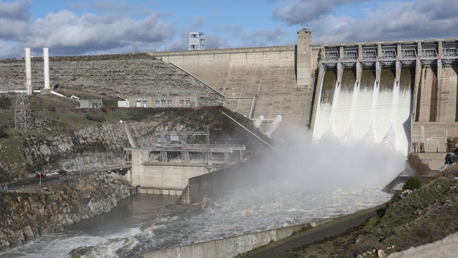 Water rushes out of Folsom Dam in Folsom, California, near Sacramento, on Dec. 16, 2016. The dam produced just 397 million kilowatt-hours of electricity in 2013, according to the U.S. Bureau of Reclamation — down from 775 million kilowatt-hours in 2011.