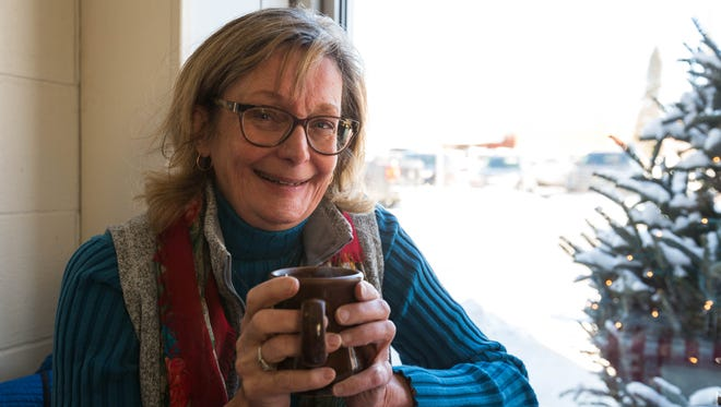 Liz Welter, reporter for USA TODAY NETWORK-Wisconsin, enjoys a warm cup of coffee at The Kitchen Table on Jan. 4, in Marshfield.