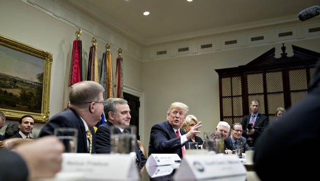 U.S. President Donald Trump, center, speaks as he meets with county sheriffs during a listening session in the Roosevelt Room of the White House on Tuesday.