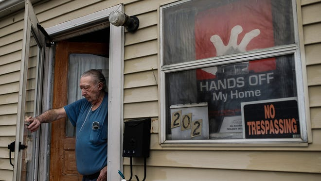 "Disabled veteran William King, 67, has placed a ""Hands Off My Home"" sign in his window indicating his stance on the city of Charlestown's efforts to remove the current residents of Pleasure Ridge. ""In the last 10 years the city has just wanted to take over everything and just wipe us out."" Feb. 7, 2017"
