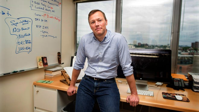 Matthew Desmond in his Cambridge, Mass., office: Desmond has won the Pulitzer Prize for a book on evictions based on his experiences in Milwaukee.